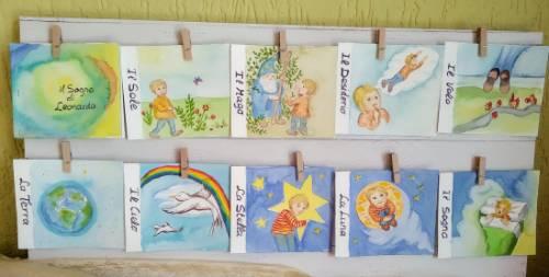 racconti brevi per bambini singole tavole appese ad un filo con le mollette